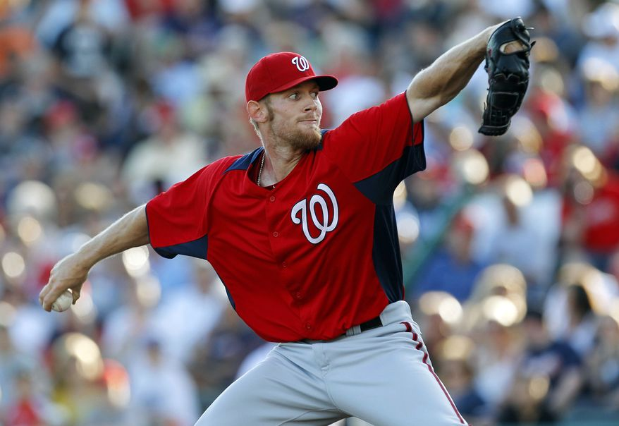 Washington Nationals pitcher Stephen Strasburg was roughed up in his third spring training outing. In four innings, he gave up four runs on five hits and two walks. He struck out one. (AP Photo/Paul Sancya)