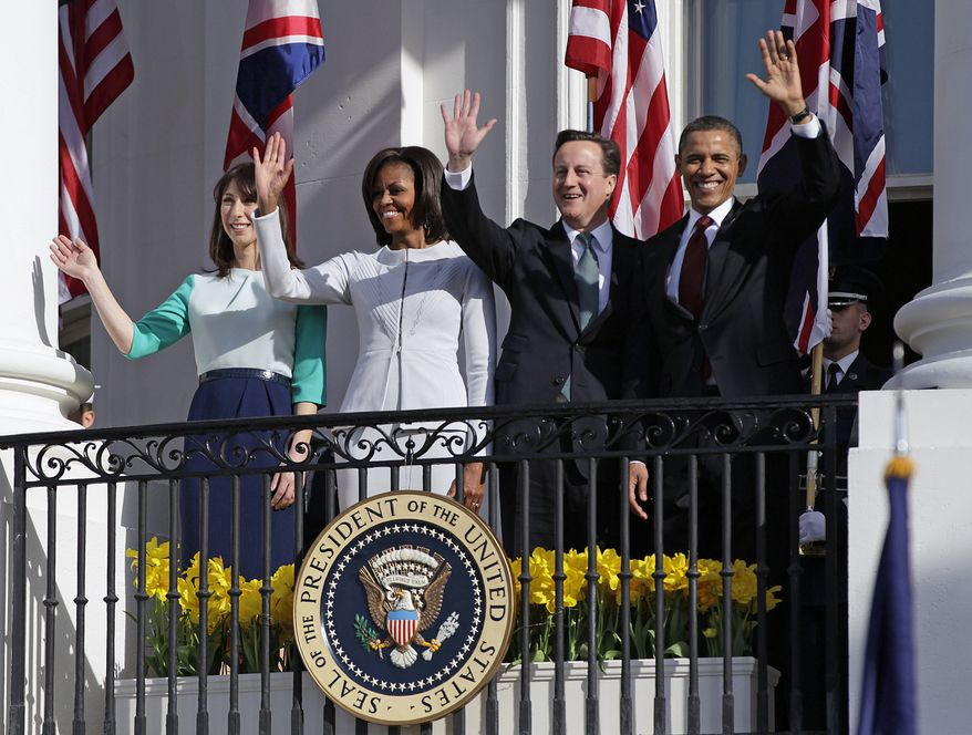 From left, Samantha Cameron, wife of British Prime Minister David Cameron, first lady Michelle Obama, British Prime Minister David Cameron and President Barack Obama wave from the balcony of the White House, Wednesday, March 14, 2012, during a state arrival ceremony on the South Lawn. (AP Photo/Carolyn Kaster)