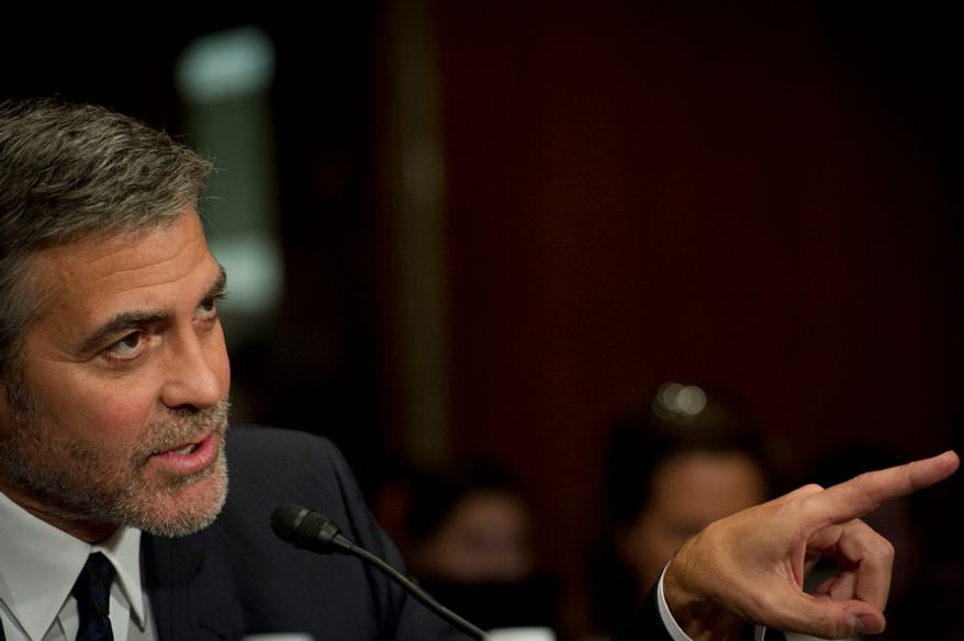 Actor George Clooney responds March 14, 2012, to questions at the Dirksen Senate Office Building on Capitol Hill during a Senate Foreign Relations Committee hearing on Sudan and South Sudan. (Rod Lamkey Jr./The Washington Times)