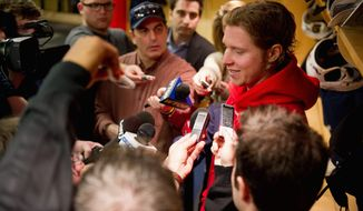 ** FILE ** Washington Capitals center Nicklas Backstrom (19) chats with reporters in the locker room after spending 35 minutes on the ice before a morning team practice at Kettler Capitals Iceplex, Arlington, Va., March 15, 2012. (Andrew Harnik/The Washington Times)