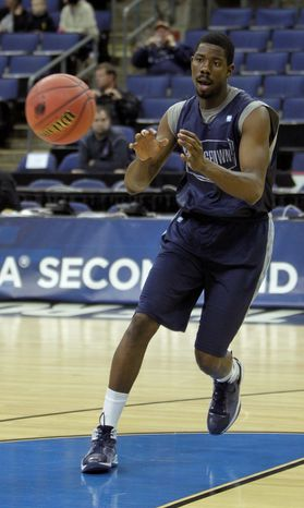 Georgetown center Henry Sims is averaging career highs in points (11.7), rebounds (6.2) and blocks (1.4) this season. (Associated Press)
