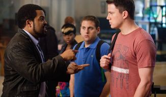 Ice Cube (left) is the surly commander of the Jump Street police division, which sends Jonah Hill (center) and Channing Tatum undercover in high school to find youth crime. (Columbia Pictures-Sony via Associated Press)