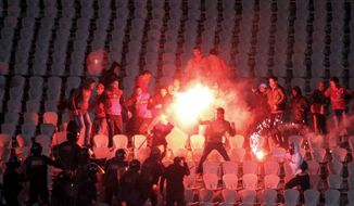 Egyptian fans clash with riot police after the al-Ahly match against al-Masry at the stadium in Port Said last month. Egypt's top prosecutor has charged 75 people with murder and negligence in connection with the deadly soccer riot last month in the Mediterranean city of Port Said.