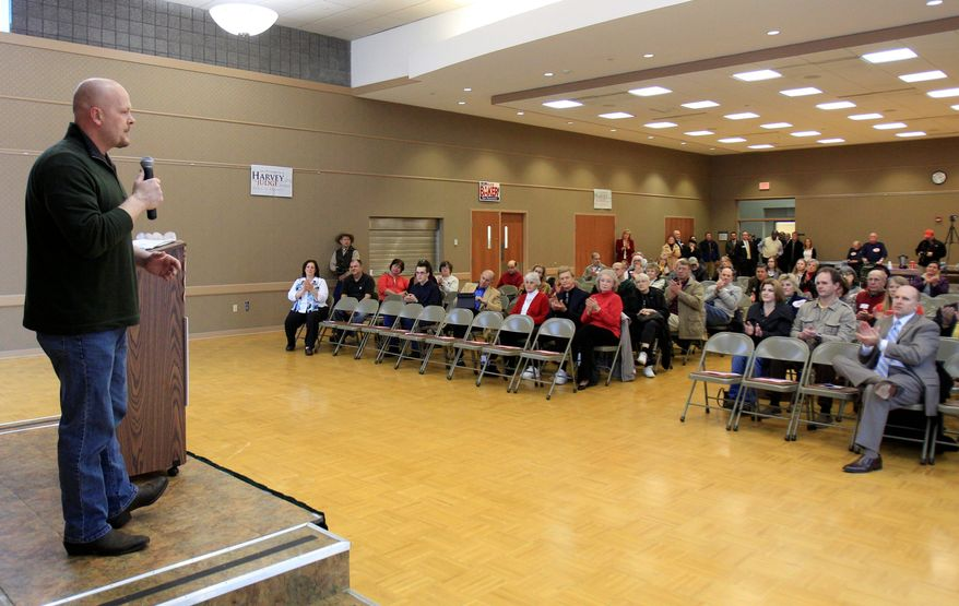 Republican congressional candidate Samuel Wurzelbacher, who's better known as Joe the Plumber, campaigns Friday, Feb. 24, 2012, in Rocky River, Ohio. Former presidential candidate Herman Cain joined Wurzelbacher on the campaign trail Friday. Wurzelbacher is facing Steve Kraus, a real estate agent from Sandusky, in the state's March 6 primary for the 9th Congressional District. (AP Photo/Tony Dejak)