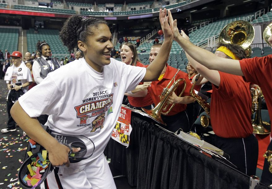Maryland's Alyssa Thomas, left, gives high-fives to members of the pep band after Maryland's 68-65 win over Georgia Tech in the NCAA Atlantic Coast Conference women's college tournament basketball championship game in Greensboro, N.C., Sunday, March 4, 2012. Thomas was the tournament MVP. (AP Photo/Chuck Burton)