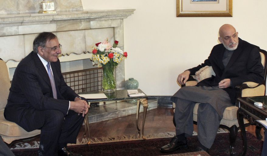 ** FILE ** U.S. Defense Secretary Leon E. Panetta (left) meets with Afghan President Hamid Karzai in Kabul, Afghanistan, on Thursday, March 15, 2012. (AP Photo/Mohammad Ismail, Pool)