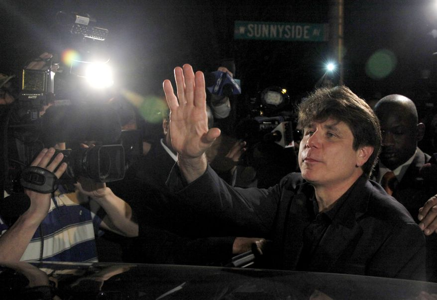 Former Illinois Gov. Rod Blagojevich departs from his Chicago home for Littleton, Colo., on Thursday, March 15, 2012, to begin a 14-year prison sentence on corruption charges. (AP Photo/Charles Rex Arbogast)