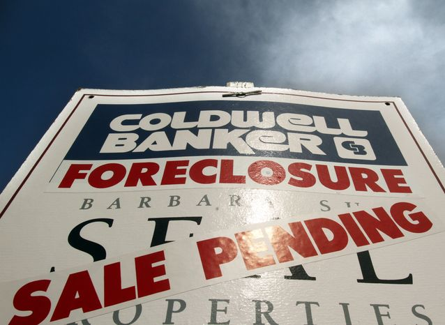 ** FILE ** A foreclosed house with a sale-pending sign is shown in Tigard, Ore., in March 2011. (AP Photo/Don Ryan)