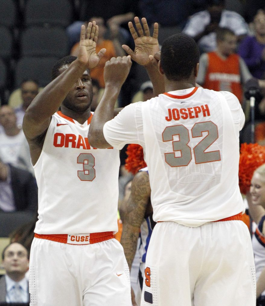 Syracuse's Kris Joseph (32) greets teammate Dion Waiters after Waiters hit a shot in the second half of an NCAA tournament second-round game against UNC-Asheville on Thursday, March 15, 2012, in Pittsburgh. Syracuse won 72-65 to advance to the next round. (AP Photo/Keith Srakocic)