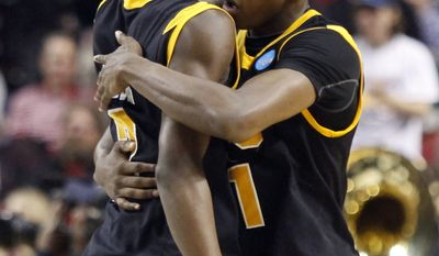 Virginia Commenwealth's Briante Webber, left, and Rob Brandenburg celebrate after defeating Wichita State in their NCAA tournament first-round college basketball game in Portland, Ore., Thursday, March 15, 2012. VCU won 62-59.(AP Photo/Don Ryan)