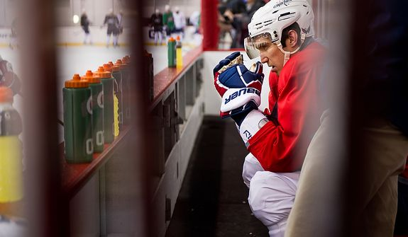 Washington Capitals left wing Alex Ovechkin (8) sits on the bench after a center ice collision with Washington Capitals right wing Mike Knuble (22) during a morning practice at Kettler Capitals Iceplex, Arlington, Va., March 15, 2012. Ovechkin stayed on the ice for two minutes and then sat on the bench for another three and a half minutes before leaving practice. (Andrew Harnik/The Washington Times)