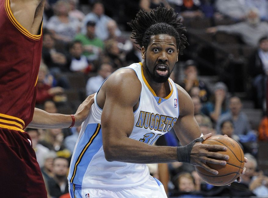 Denver Nuggets center Nene (31) drives against the Cleveland Cavaliers during the Cavaliers' 100-99 on March 7, 2012, in Denver. (Associated Press/The Denver Post)
