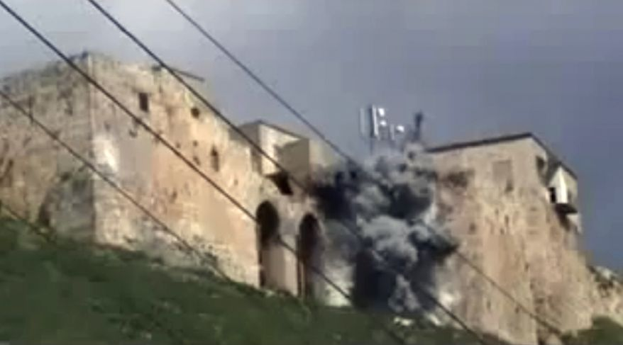 This image made from amateur video and released by Shaam News Network on March 15, 2012, purports to show an attack on a castle in Hama, Syria. (Associated Press/Shaam News Network via APTN)