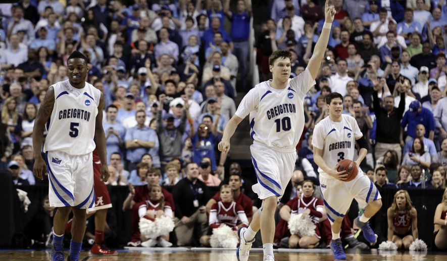 Creighton's Grant Gibbs (10), Josh Jones (5) and Doug McDermott (3) celebrate following a Midwest Regional NCAA tournament first-round college basketball game against Alabama in Greensboro, N.C., Friday, March 16, 2012. Creighton won 58-57.(AP Photo/Gerry Broome)