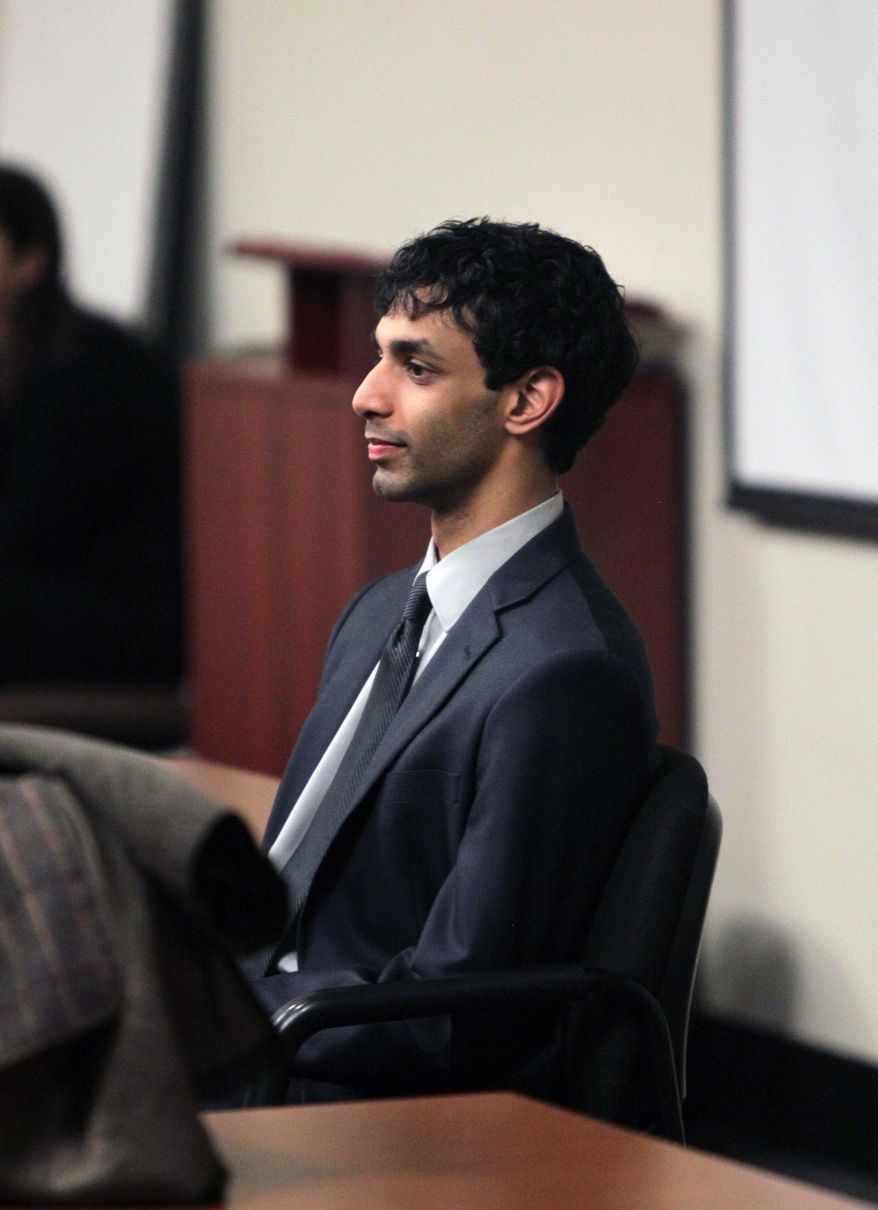 Dharun Ravi enters the courtroom March 15, 2012, during jury deliberations at the Middlesex County Courthouse in New Brunswick, N.J. Ravi, a former Rutgers University student, faces 15 criminal charges, including invasion of privacy and bias intimidation, a hate crime. His freshman-year roommate, Tyler Clementi, jumped to his death from the George Washington Bridge in September 2010, just days after Clementi's intimate encounter with another man. (Associated Press)