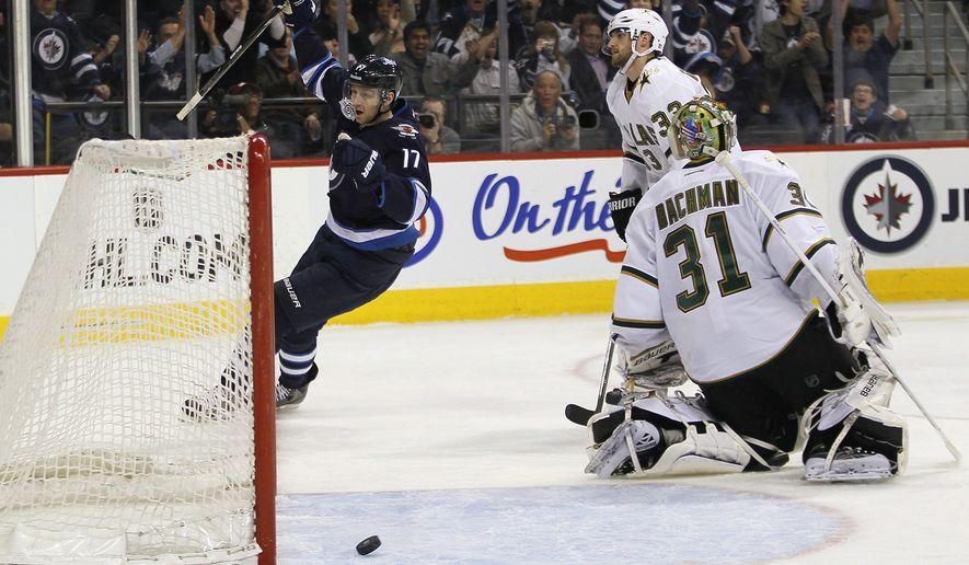 Winnipeg Jets' Eric Fehr (17) celebrates his goal on Dallas Stars' goaltender Richard Bachman during second period in Winnipeg, Manitoba, on Wednesday, March 14, 2012. (AP Photo/The Canadian Press, John Woods)