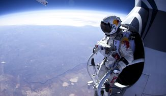 In this photo provided by Red Bull Stratos, skydiver Felix Baumgartner prepares to jump during the first manned test flight for Red Bull Stratos over Roswell, N.M., on March 15, 2012. Baumgartner plans to jump from nearly 23 miles in the summer. The record is held by Joe Kittinger who jumped from 19.5 miles in 1960. (Associated Press/Red Bull Stratos)