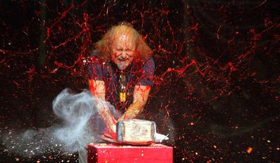 ** FILE ** In this Nov. 18, 2006, file photo, comedian Gallagher smashes strawberry syrup and flour at the end of his performance at the Five Flags Theater in Dubuque, Iowa. Gallagher is hospitalized in stable condition after suffering a heart attack at a North Dallas bar before going on stage for a show Wednesday night, March 14, 2012. (AP Photo/Telegraph Herald, Jeremy Portje, File)