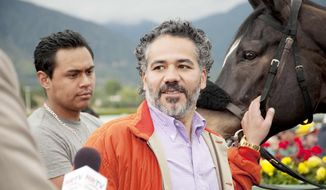 "In this undated image provided by HBO, John Ortiz appears in a scene from the HBO original series ""Luck."" The HBO TV channel ended the racing series ""Luck"" after three horses used in the realistic production were injured and euthanized over a period stretching from 2010 to last week. (AP Photo/HBO, Gusmano Cesaretti)"