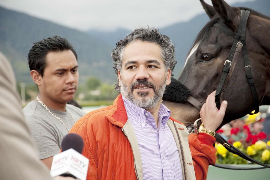"""In this undated image provided by HBO, John Ortiz appears in a scene from the HBO original series """"Luck."""" The HBO TV channel ended the racing series """"Luck"""" after three horses used in the realistic production were injured and euthanized over a period stretching from 2010 to last week. (AP Photo/HBO, Gusmano Cesaretti)"""