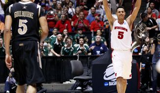 Wisconsin forward Ryan Evans celebrates the win as Vanderbilt forward Lance Goulbourne walks off as time expires in the NCAA tournament third-round college basketball game on Saturday, March 17, 2012, in Albuquerque, N.M. Wisconsin won 60-57. (AP Photo/Matt York)