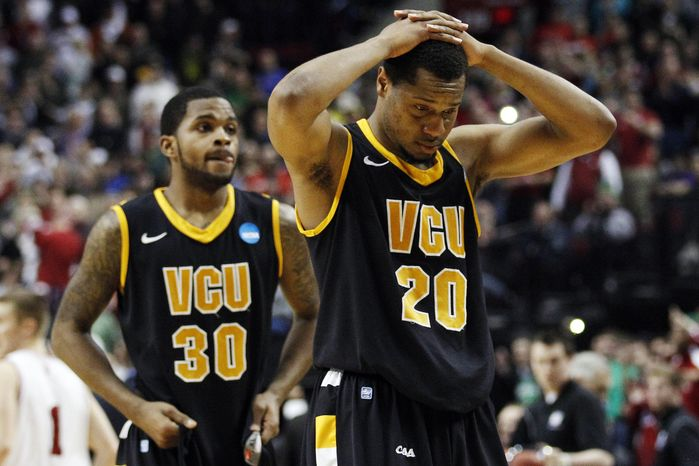 Virginia Commonwealth''s Bradford Burgess (20) and Troy Daniels (30) walk off the court after losing 63-61 to Indiana during an NCAA college tournament third-round game in Portland, Ore., Saturday, March 17, 2012. (AP Photo/Rick Bowmer)