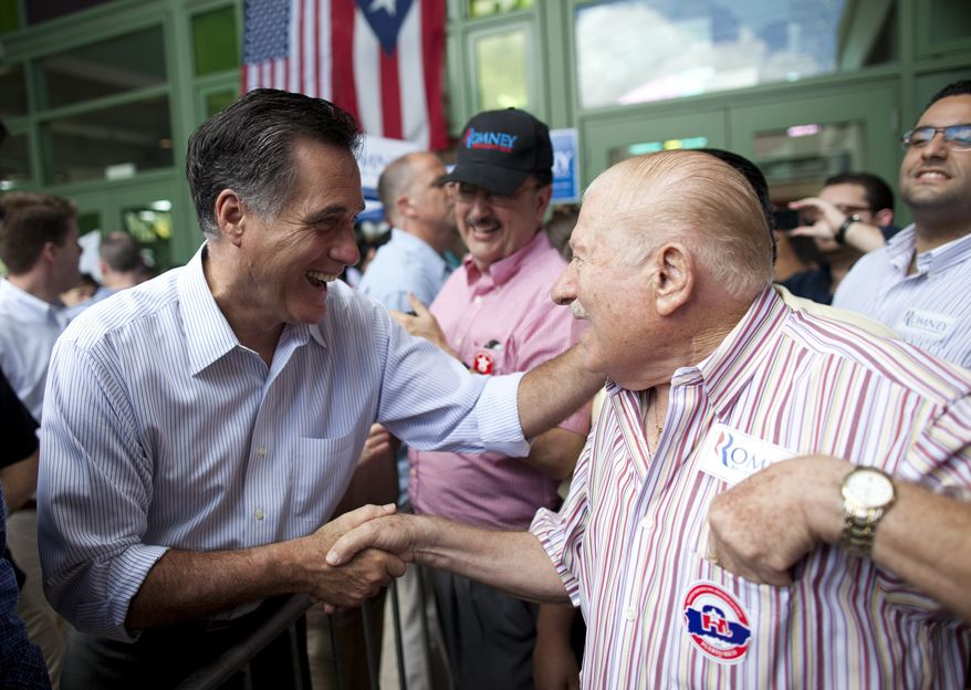 ** FILE ** Republican presidential candidate, former Massachusetts Gov. Mitt Romney shakes hands during a campaign stop on Saturday, March 17, 2012, in Bayamon, Puerto Rico. (AP Photo/Evan Vucci)