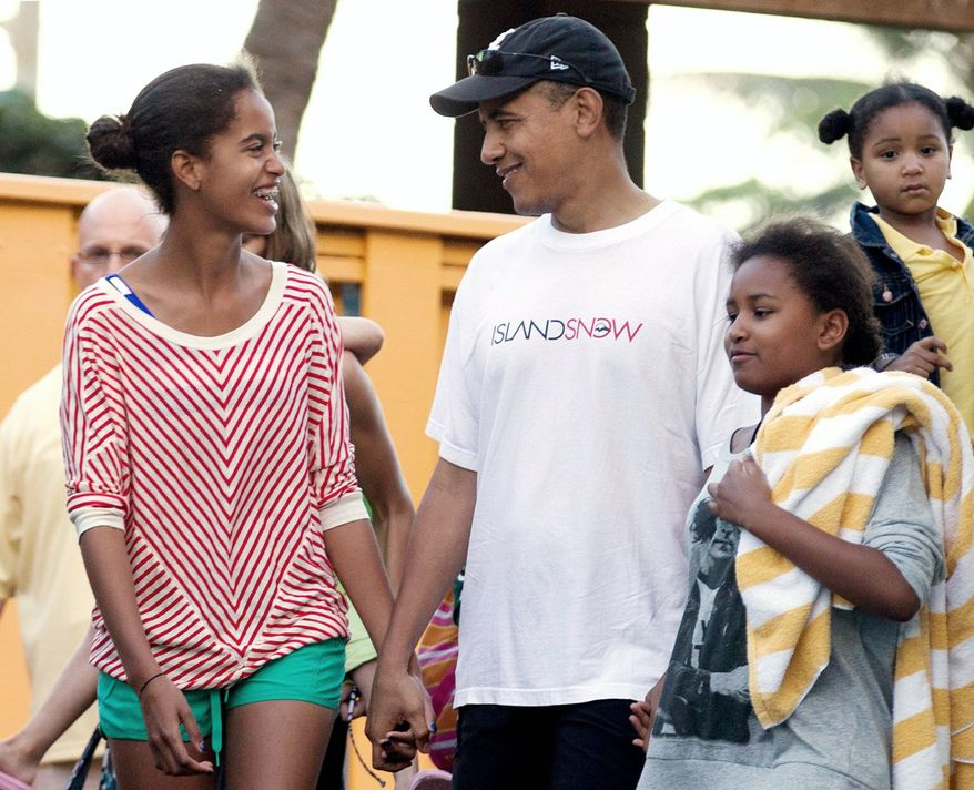 President Obama holds hands with his daughters, Malia (left) and Sasha, as they leave Sea Life Park, a marine wildlife park, with family friends in Waimanalo, Hawaii, in December. (Associated Press)
