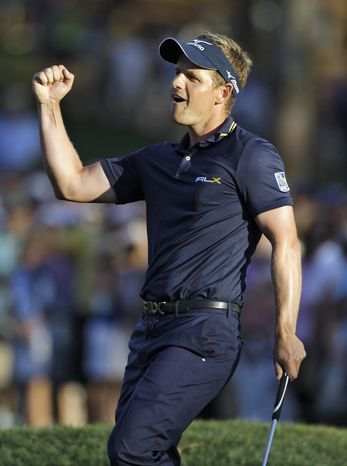 ASSOCIATED PRESS Luke Donald celebrates after winning a four-man playoff on the first extra hole in the Transitions Championship.