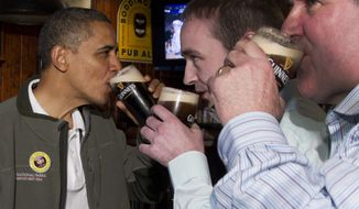 ** File ** President Obama drinks a Guinness at the Dubliner Restaurant and Pub on St. Patrick's Day, March 17, 2012, in Washington. (Associated Press)