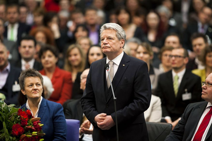 Newly elected German President Joachim Gauck reacts after he was chosen by a special federal assembly in Berlin on Sunday, March 18, 2012. (AP Photo/Markus Schreiber)