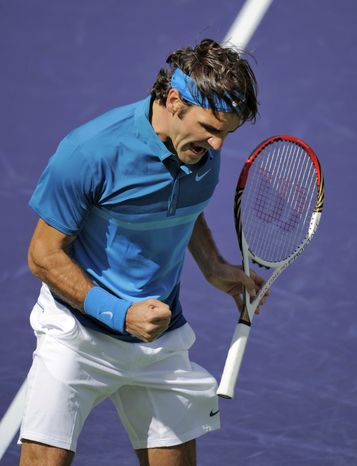 Roger Federer reacts after winning the first set over John Isner, of the United States, in the men's final at the BNP Paribas Open tennis tournament, Sunday, March 18, 2012, in Indian Wells, Calif. Federer won 7-6 (7), 6-3. (AP Photo/Mark J. Terrill)