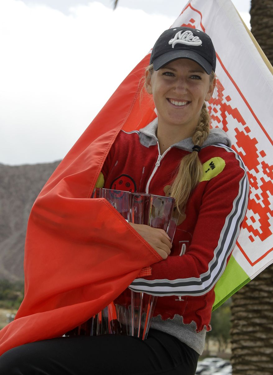 Victoria Azarenka poses with the championship trophy after defeating Maria Sharapova 6-2-6-3 in the women's final at the BNP Paribas Open tennis tournament Sunday, March 18, 2012, in Indian Wells, Calif. (AP Photo/Darron Cummings)