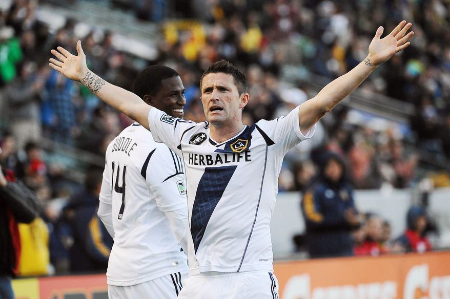 Los Angeles Galaxy forward Robbie Keane celebrates after scoring against D.C. United during the second half of an MLS soccer match, Sunday, March 18, 2012, in Carson, Calif. (AP Photo/Jonathan Moore)