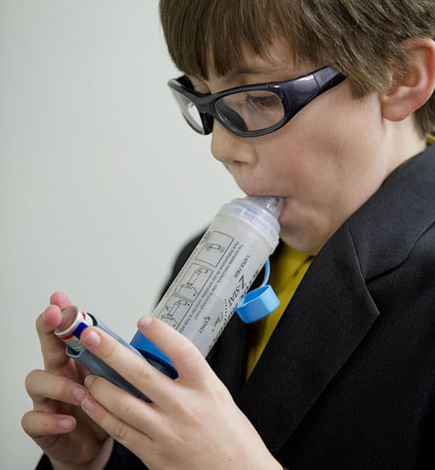 Forrest Johnston, who is asthmatic, uses an inhaler before competing in the National Trumpet Competition at George Mason University on Friday, March 16, 2012. Because of the recent warm weather, Forrest's allergies are acting up, making it more difficult for him to breathe, which affects his ability to play.  (Barbara L. Salisbury/The Washington Times)