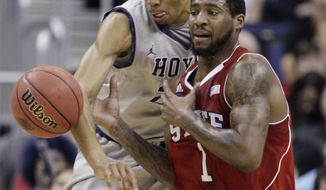 Georgetown's Otto Porter. left, and North Carolina State's Richard Howell (1) battle for a loose ball during the first half of an NCAA men's college basketball tournament third-round game in Columbus, Ohio, Sunday, March 18, 2012. (AP Photo/Jay LaPrete)