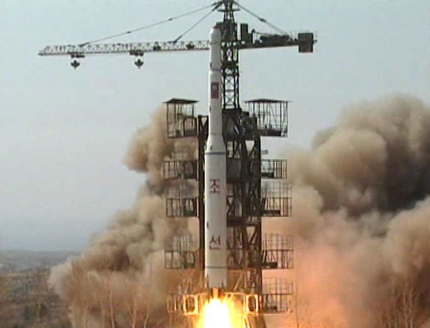** FILE ** A rocket lifts off from the launch pad in Musudan-ri, North Korea, in April 2009. (AP Photo/KRT TV, File)