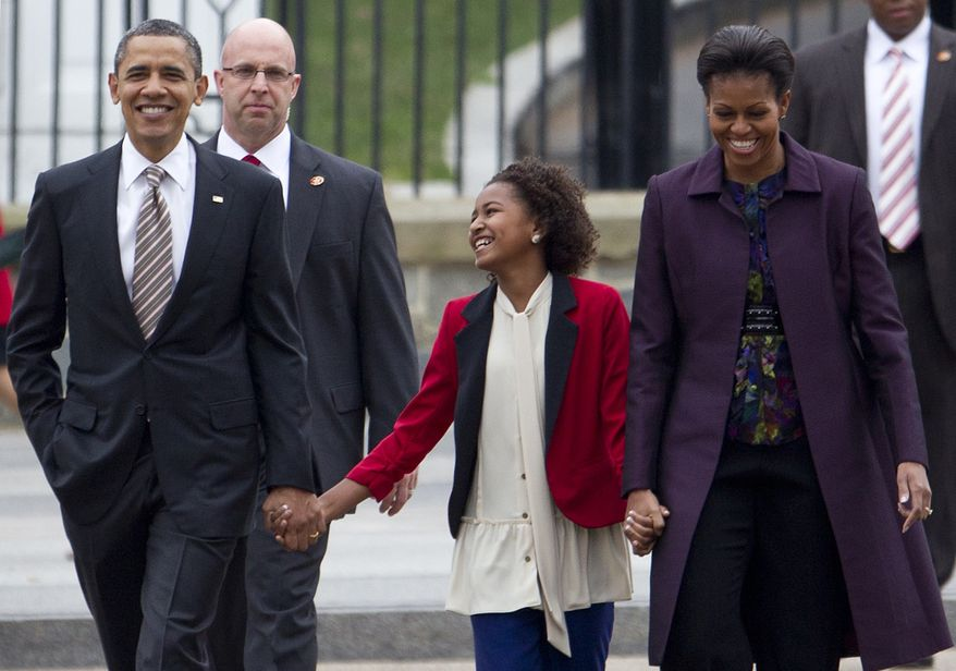 President Obama, first lady Michelle Obama and daughter Sasha hold hands as they walk from the White House through Lafayette Park to attend services at St. John's Episcopal Church in Washington on Sunday, March 18, 2012. (AP Photo/Carolyn Kaster)