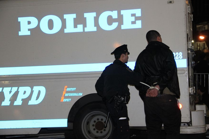 Police arrest an Occupy Wall Street protester early on Sunday, March 18, 2012, in Zuccotti Park in New York after a march in celebration of the protest's sixth month. (AP Photo/Albert Sabate)