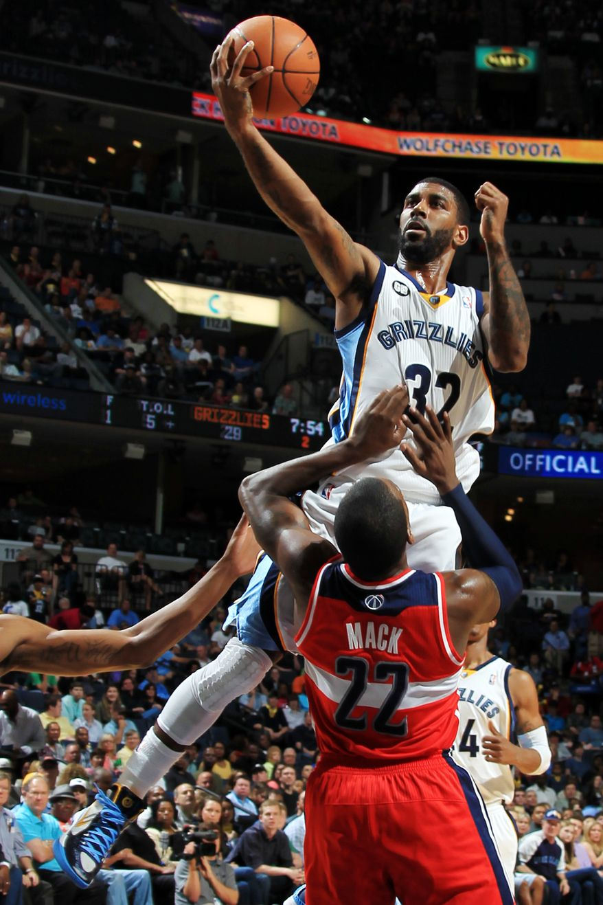 Memphis Grizzlies guard O.J. Mayo (32) shoots over Washington Wizards guard Shelvin Mack (22) in the first half of an NBA basketball game on Sunday, March 18, 2012, in Memphis, Tenn. Mayo was called for an offensive foul on the play. (AP Photo/Nikki Boertman)