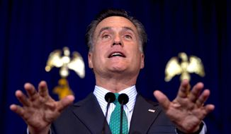 Republican presidential hopeful Mitt Romney, speaking at the University of Chicago, said some of the nation's foremost inventors of an earlier era would have suffocated under the weight of the regulatory burden of today's federal government. (Associated Press)