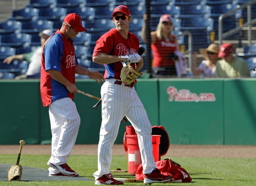Philadelphia second baseman Chase Utley (right) missed all of spring training and the first 46 games of the regular season in 2011 because of knee problems. (Associated Press)