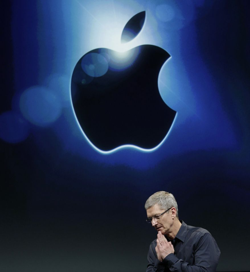 """Apple CEO Tim Cook said that, with as much cash as Apple has on hand, a dividend won't restrain the company's options. """"These decisions will not close any doors for us,"""" he said. Mr. Cook said Apple looked at how much domestic cash it had, then set aside enough for planned investments and unforeseen outlays. (Associated Press)"""