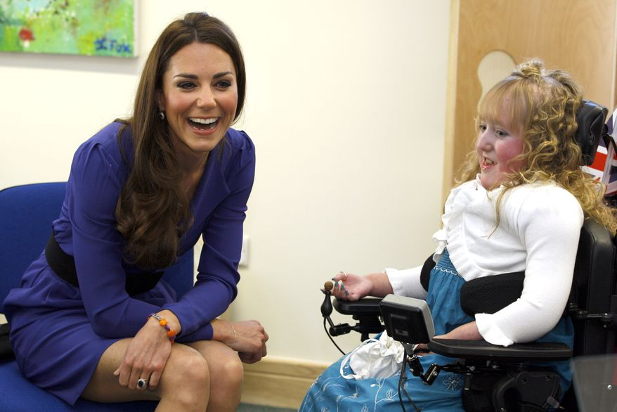 Britain's Duchess of Cambridge meets Bethany Woods in a music class on March 19, 2012, during a visit to The Treehouse in Ipswich, England. The Duchess of Cambridge visited to formally open The Treehouse, a children's hospice service for Suffolk and Essex. (Associated Press)