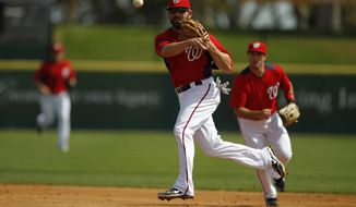 Washington Nationals second baseman Danny Espinosa makes a throw to first against the Houston Astros during a spring training baseball game in Viera, Fla., Thursday, March 8, 2012. (AP Photo/Paul Sancya)