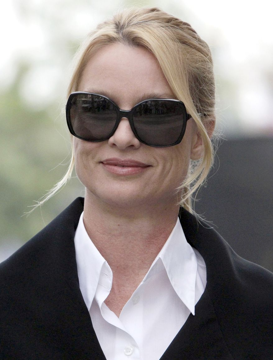 """FILE - In this March 15, 2012 file photo, Nicollette Sheridan arrives at court in Los Angeles. A judge declared a mistrial Monday in Nicollette Sheridan's wrongful termination trial after the jury deadlocked, leaving an unresolved finale to a two-week trial that focused on the behind-the-scenes intrigue and personalities of TV's """"Desperate Housewives."""" (AP Photo/Nick Ut)"""