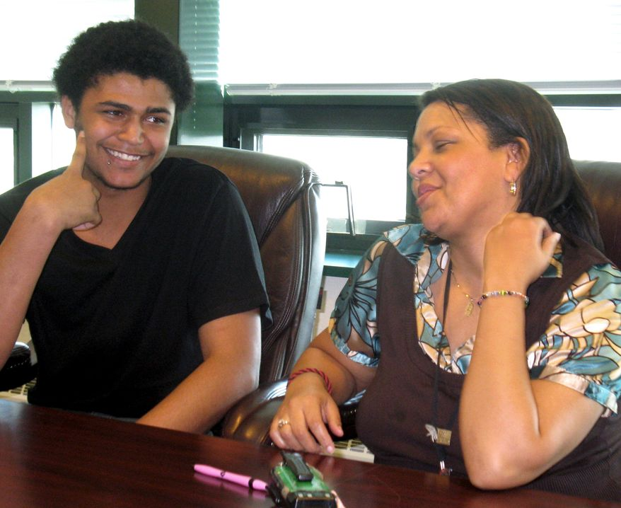 Alton Burke (left), 17, a senior at South Hagerstown High School in Hagerstown, Md., talks with student intervention specialist Heather Dixon on Wednesday, March 14, 2012. (AP Photo/Kimberly Hefling)