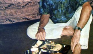 In this undated photo made available by the driver accompanying Italian tourists, abducted Italian tourist Paolo Bosusco eats a meal at an undisclosed location in India. Maoist rebels have abducted two Italian men in a poor eastern Indian state and demanded that the state government stop all anti-Maoist operations in return for their release, police and the rebels said Sunday, March 18, 2012. (AP Photo)