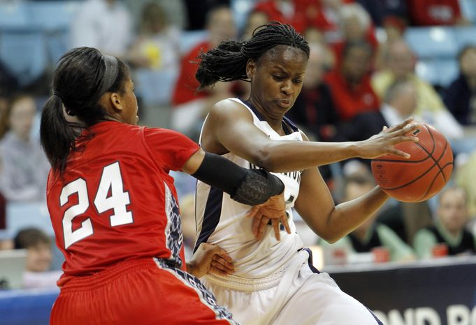 Georgetown's guard Sugar Rodgers (14) drives to the basket past Fresno State's guard Ki-Ki Moore (24) during the second half of NCAA tournament first-round women's college basketball game in Chapel Hill, N.C., Sunday, March 18, 2012. Georgetown won 61-56. (AP Photo/Jim R. Bounds)