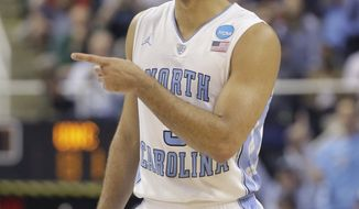 North Carolina's Kendall Marshall gestures to a teammate late during the second half of a Midwest Regional third-round NCAA tournament college basketball game against Creighton in Greensboro, N.C., Sunday, March 18, 2012. (AP Photo/Chuck Burton)